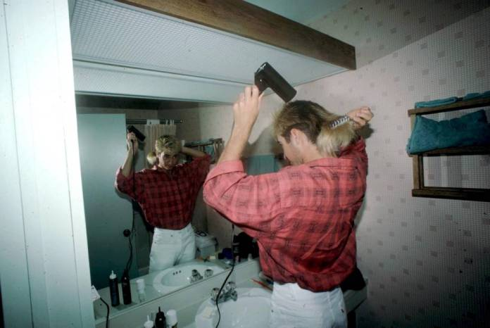 Tennis player Andre Agassi dries his hair. Then he would bald.