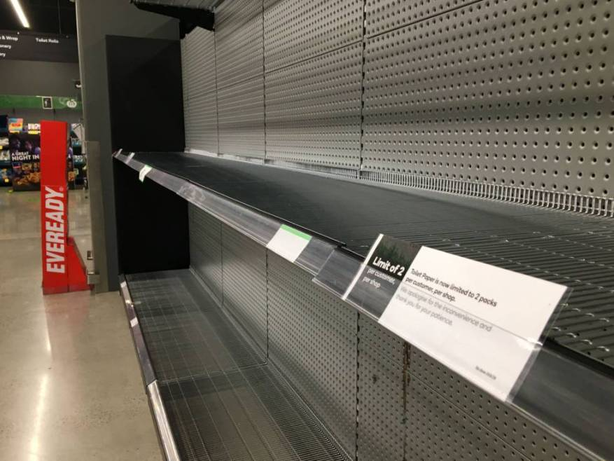 Empty supermarket shelves at a Woolworths supermarket in Melbourne, Australia, after toilet paper ran out.