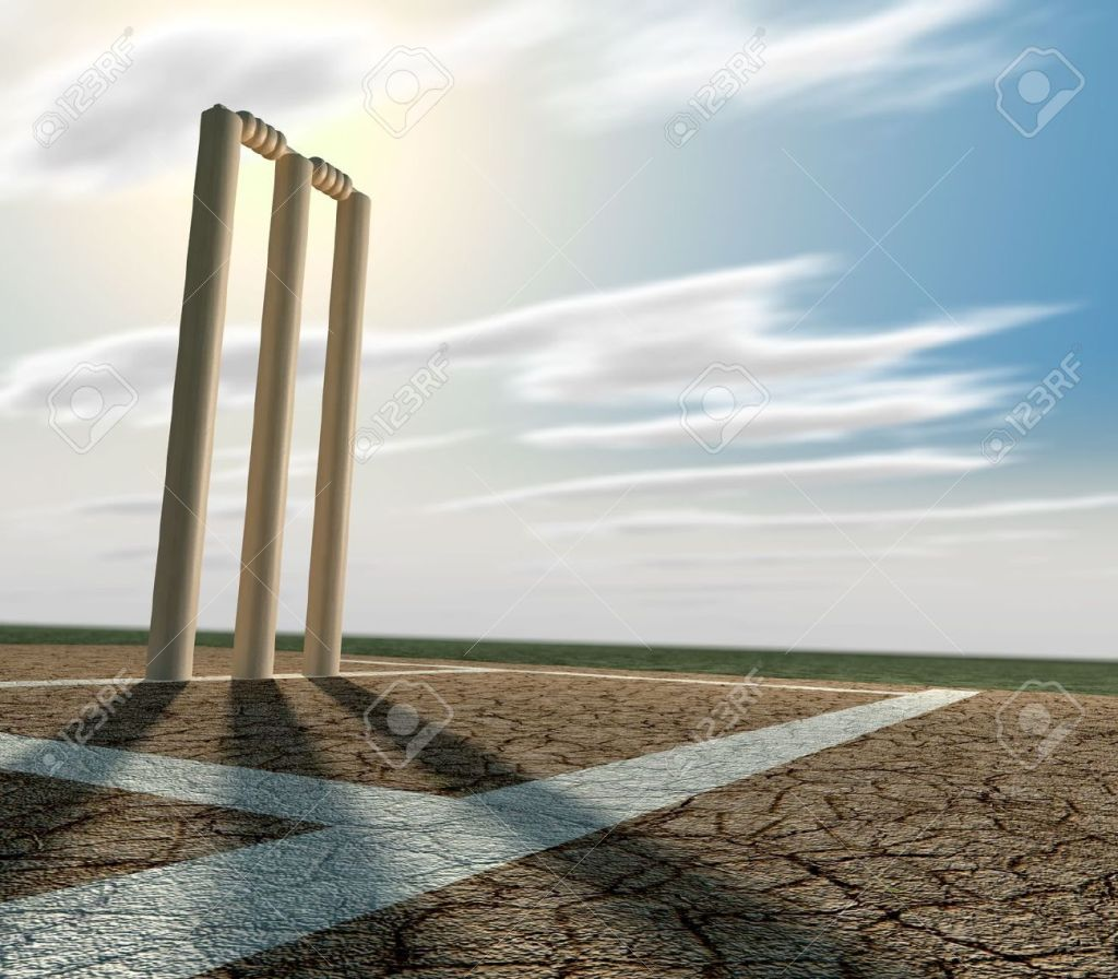 18797691-a-set-of-cricket-wickets-set-up-on-a-cracked-cricket-pitch-with-white-markings-on-a-blue-sky-backgro-stock-photo