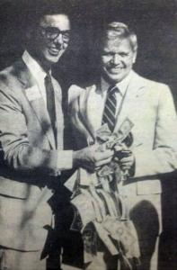 """Roy Terwilliger and Billy Bye cut a """"ribbon"""" made of dollar bills to celebrate the Foundation's birth."""