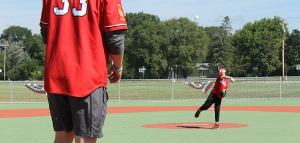 A young boy throws a pitch at the first ever ballgame held at Eden Prairie's Miracle Field.