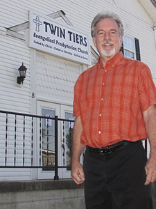 Pastor Paul Irwin stands outside the new home of Twin Tiers Church in Big Flats, N.Y.