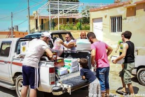 An indigenous Iraqi ministry distributes both food and spiritual sustenance to Iraqi's displaced people.