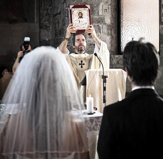 Italy, Umbria, catholic priest during the wedding liturgy