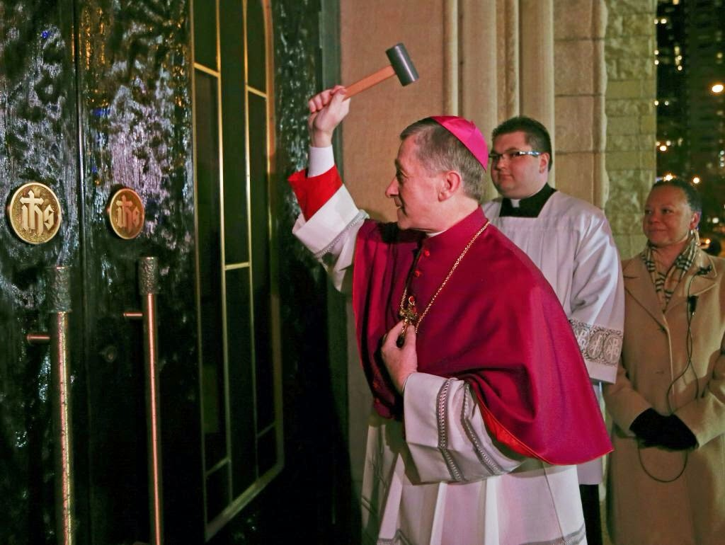 cupich smashes least favorite part of cathedral with rubber mallet