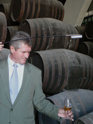 Pepe Gomez demonstrates the use of the valencia (traditional wine thief) in Osborne's sherry cellar