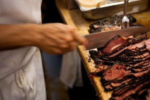 Cutting the pastrami by hand
