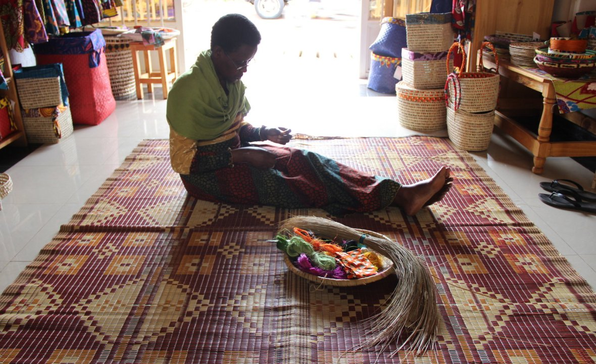 Grace showing curious travellers how to weave