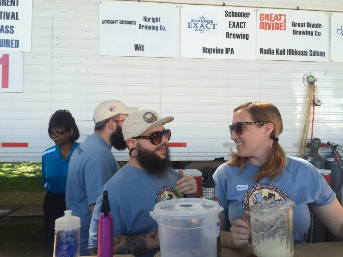 Women volunteers pour beer at 2016 OBF.