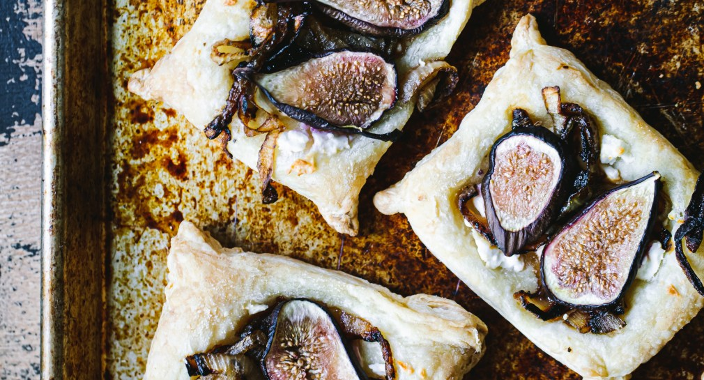 The fig tarts sitting baked on the pan