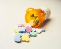 Love Pills Spilling from Prescription Bottle