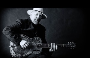 PK Mayo playing acoustic guitar, EPK home page