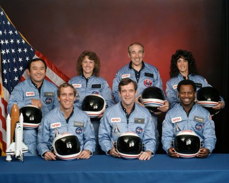 The STS-51L crewmembers are: in the back row from left to right: Mission Specialist, Ellison S. Onizuka, Teacher in Space Participant Sharon Christa McAuliffe, Payload Specialist, Greg Jarvis and Mission Specialist, Judy Resnik. In the front row from left to right: Pilot Mike Smith, Commander, Dick Scobee and Mission Specialist, Ron McNair.
