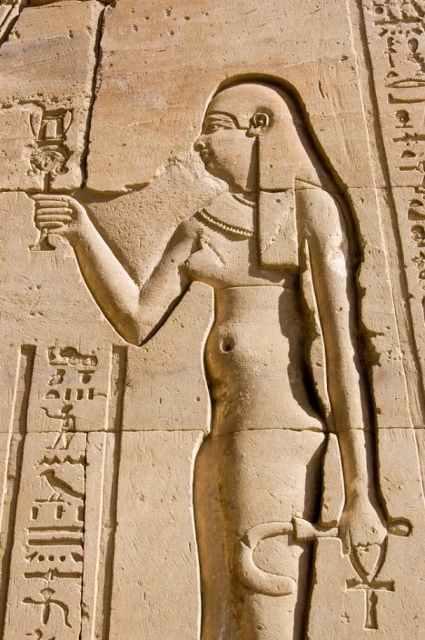 Carving of the Ancient Egyptian queen Cleopatra. Wall of the Temple of Horus at Edfu, Egypt.
