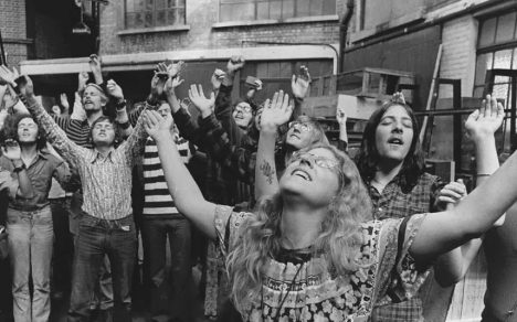Members of the 'Children of God' worshipping in Bromley, Kent in the 70s