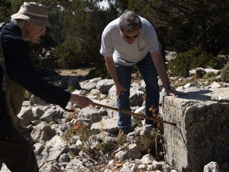 Epigrapher Martin Ferguson Smith (left) and his colleague Jürgen Hammerstaedt examine a stone block inscribed with the tenets of Epicureanism. The two scholars recently worked with an archaeological team that mapped Oinoanda. Its thorough surface survey revealed 75 previously unknown fragments of the inscription.