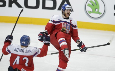 Czech Republic's Jakub Voracek, right, celebrates with his teammate Jan Kovar, left, after scoring during the Hockey World Championships Group A match against Latvia in Prague, Czech Republic, Saturday, May 2, 2015. (AP Photo/Petr David Josek)