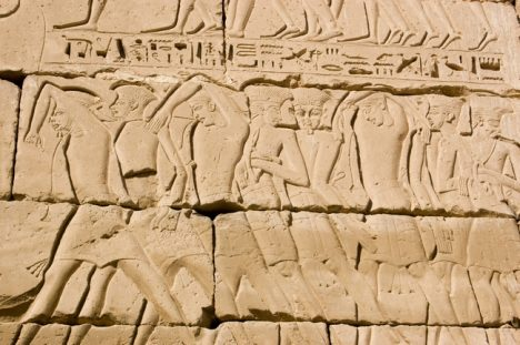 Slaves hieroglyphs Egypt An ancient Egyptian hieroglyphic carving of captured slaves, or prisoners of war. Carved into a wall of Medinet Habu Temple on the West Bank of the Nile at Luxor.