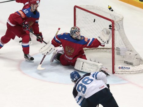 Finland's Jussi Joking, bottom, scores past Russia's goalie Sergei Bobrovski, center, during the Ice Hockey World Championships semifinal match between Finland and Russia, in Moscow, Russia, on Saturday, May 21, 2016. (AP Photo/Ivan Sekretarev)