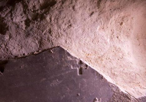 Inscribed with a Christian cross, this broken marble slab may date to the Crusades