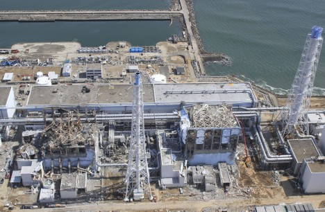 In this March 24, 2011 aerial photo taken by a small unmanned drone and released by AIR PHOTO SERVICE, damaged Unit 3, left, and Unit 4 of the crippled Fukushima Dai-ichi nuclear power plant are seen in Okumamachi, Fukushima prefecture, northern Japan. (AP Photo/AIR PHOTO SERVICE) MANDATORY CREDIT
