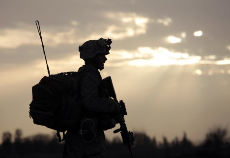 A U.S. Marine from Bravo Company of the 1st Battalion, 6th Marines walks during an operation in Marjah, Helmand province February 21, 2010. NATO forces are facing strong resistance eight days into a major offensive in southern Afghanistan as Taliban fighters dig in to fight to the death. REUTERS/Goran Tomasevic (AFGHANISTAN - Tags: MILITARY CONFLICT)