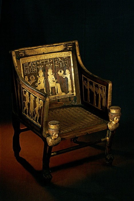Yuya and Tuyu's granddaughter Sitamun gave them this gilded wooden chair. Two similar scenes on the back show servants presenting gold necklaces to a seated Sitamun. The hieroglyphic text says these gifts came from