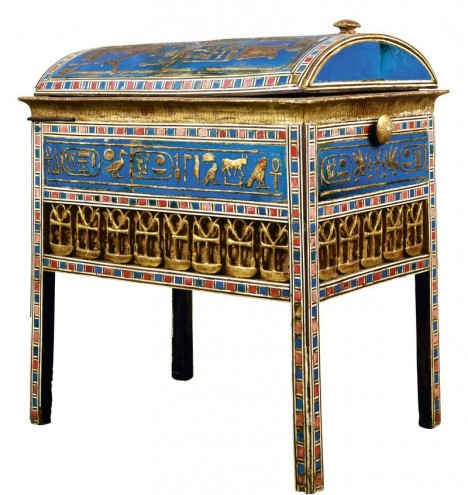 A wooden box decorated in gold, ebony, ivory, and blue ceramic tiles may once have held jewelry. Pink linen lined the inside.
