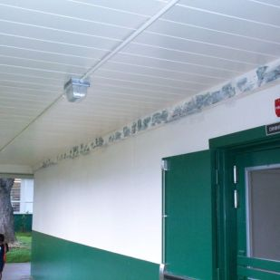 L. Long cafeteria corridor perimeter beams injected and finish sanded ready for paint.