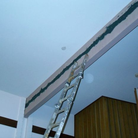 B. The crack is surface sealed with epoxy paste. Tubing is drilled into the crack at several intervals.