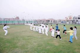 Youngsters learning Karaate in DHA Lahore Sports Complex