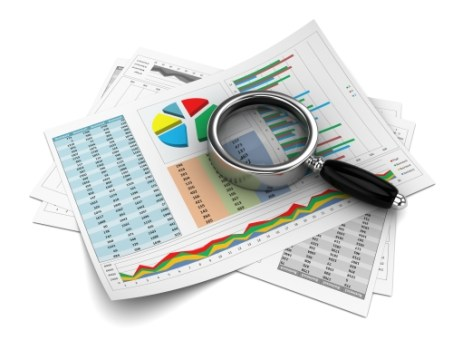 Business report with magnifying glass
