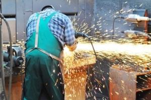 A man works in steel industry