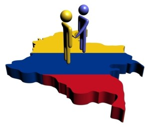 People shaking hands with Colombia map flag illustration