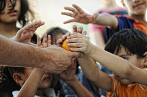 Children fighting for an orange