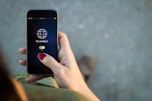 Woman walking smartphone interface roaming