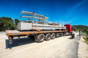 Truck transporting construction materials.