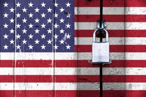 United states of america flag on a wooden door locked with a padlock, concept background with copy space