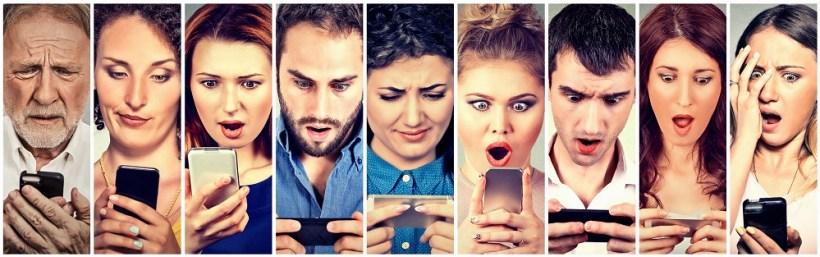 Surprised shocked group of people men women texting on smart phone