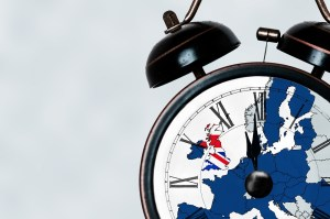 Brexit deadline concept. With an alarm clock at almost 12 o'clock. With the flags of the Union Jack and the E.U over layered on top.