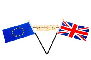 The flags of the European Union and the United Kingdom isolated on a white background with a sign reading Citizens Rights