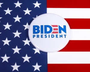 London, UK - May 5th 2020: Joe Biden 2020 pin badge portraying his campaign to run for President of the United States of America in 2020. The badge is pictured over the USA Flag.