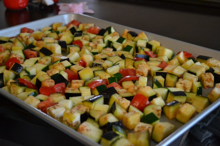 Roast any variety of vegetables. I used eggplant, zucchini & tomatoes.