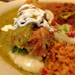 The chile relleno oozing a ton of cheese.