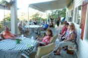 Several of us enjoying Happy Hour in the 100 degree heat on Gayle & Steve's deck