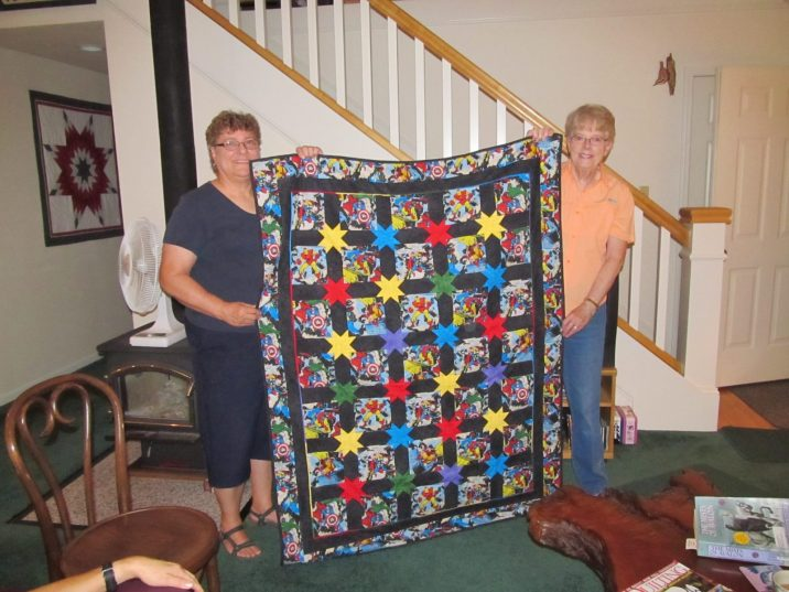 Dora and Meridel show their donation quilt
