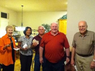Money winners. Marcia McIntyre, Aleli & Lonnie Lawson, Howard Tally and Griff Griffin