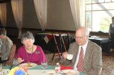 Program chair, Carolyn Stieber and speaker, Roger Mullaly enjoy good conversation and lunch.