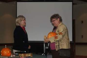 Lenita Blake and Dora Moore enjoy some good conversation. The hand-carved pumpkins went home with members to enjoy.