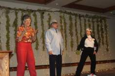 """Carolyn Stieber, program coordinator, our distinguished Club president, maxine Williams and member Ida Tolmie, performed their own interpretation of the classic Christmas song: """"I'm Getting Nuttin' for Christmas""""."""